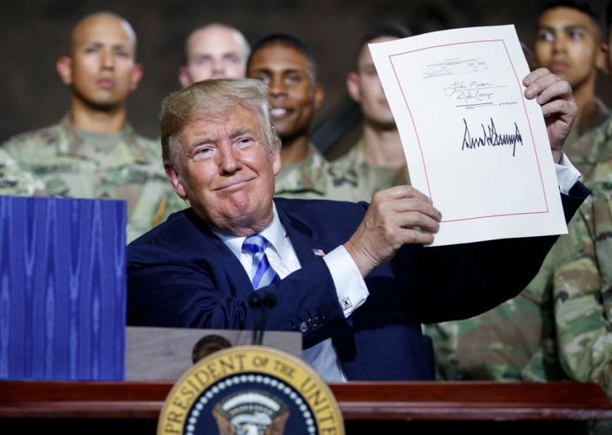 Trump Signs $716 Billion Military Spending Bill