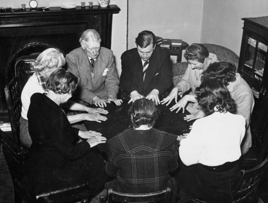 a group of CIA psychics at a round table
